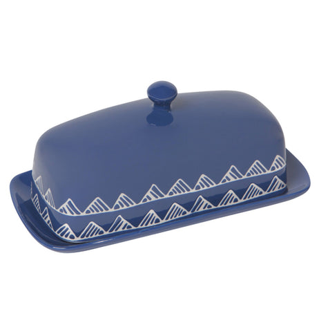 A Blue butter dish with a design of two rows of mountains running along the bottom