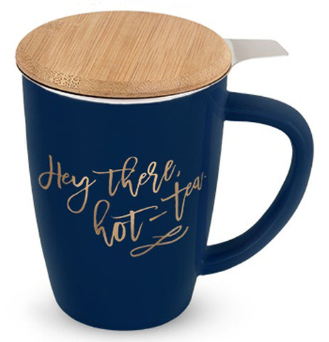 Blue tea mug with Hey There Hot Tea written in gold on front with tan bamboo lid and stainless steel infuser on a white background.