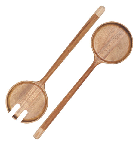 Two light brown wooden salad tongs are angled from the top right corner to the bottom left corner. The tips of each salad tong are a lighter brown.