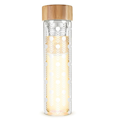 Glass travel mug with floral design with a tan bamboo lid on top with a silver colored stainless steel infuser on a white background.