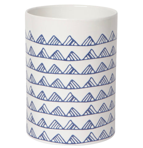 This large and tall white utensil crock has patterns of blue mountain top designs covering it.