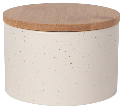 A large circular tan grey canister with grey speckles with a brown fitted lid.