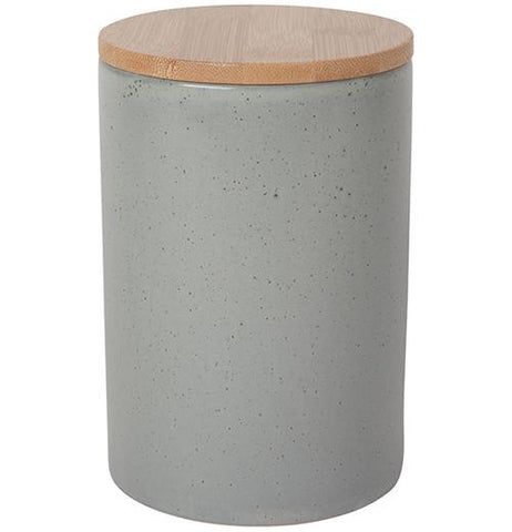 Large, gray, stone canister with a wooden cap on top.