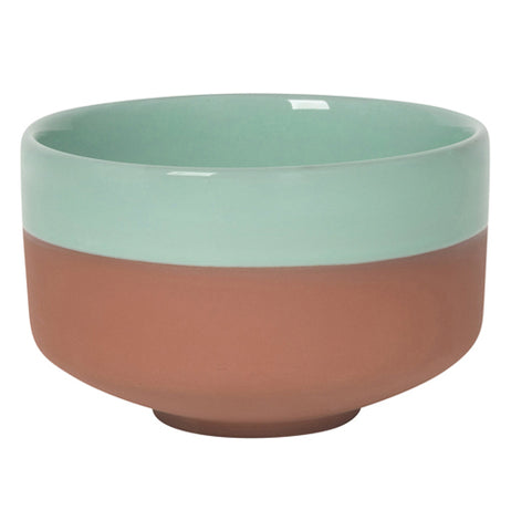 This Dip Bowl Terra Cotta is half unglazed on the bottom and light green glazed on the top which is made for soups and other stuff.