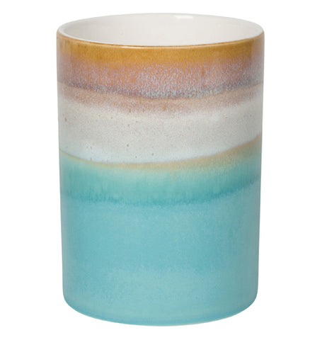 Multi-colored sky gradient utensil crock, burnt orange at the top, sand color below, and aqua at the bottom.