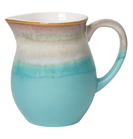 Gradient toned blue and white water pitcher.