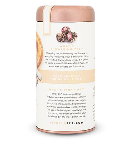 "A tall cylinder shaped, cream colored container with a copper lid. The questions ""What's Flowering Tea?"" and ""What's Pinky Up?"" are printed in gold and the answers are printed in black. This is the back of the container."