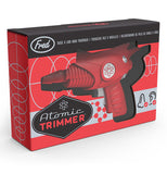 "The ""Atomic Trimmer"" is being packaged in red and black box."