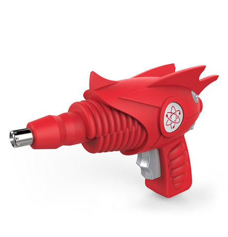 "The ""Atomic Trimmer"" is a grooming tool shaped like a red ray gun with an atomic symbol on its side."