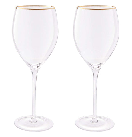 These two wine glasses each have a golden colored rim at their tops.