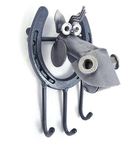 This metal horseshoe shaped sculpture features another metal sculpture shaped like a horse's head. Below the horseshoe is a set of three hooks for hanging keys.