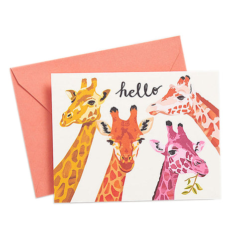 "Orange envelope and a card with 4 giraffes that are yellow, bold orange, pink, and spotted orange.  The card says ""Hello"" on the front."