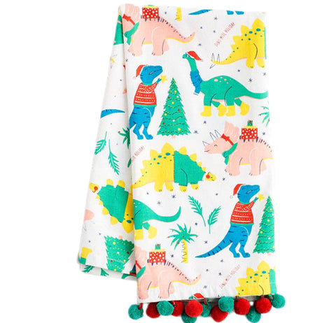 It's a dinosaur tea towel with different colored dinosaurs wearing Santa hats and Christmas sweaters on it with Christmas tree's