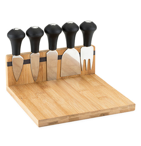 The Brace Magnetic Cheese Board and Tool Set is made of wood with a long magnetic strip to hold five tools.