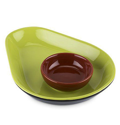 This green avocado-shaped tray has a smaller brown bowl sitting in it.