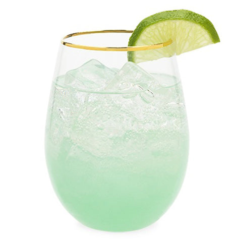 Gold rimmed wine sea green glass filled with white wine and ice with lime wedge for garnish.