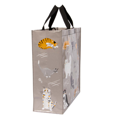 The side of the bag is shown with a orange tabby cat, a gray and white cat, and a white cat with black and orange stripes.