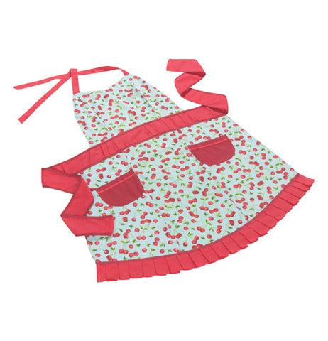 White ladies apron with a red cherry pattern all over, shown laid flat. Apron has 2 red pockets at the hip, a red waist band, red neck band, and red ruffle on the bottom edge.