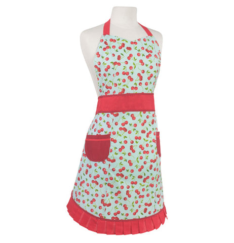 White ladies apron with a red cherry pattern all over, shown hanging on a mannequin bust. It has 2 red pockets at the hip, a red waist band, red neck band, and red ruffle on the bottom edge.