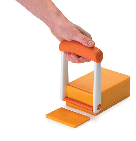 The slicer cuts through the cheese with the roller keeping the slice flat and even
