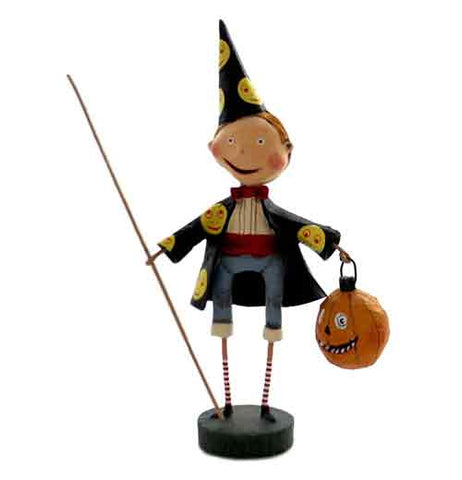This figurine is of a wizard holding a long staff in one hand, a pumpkin shaped trick or treat bag in the other, and wearing a pointed black hat and black coat, which both have yellow smiling faces on them.