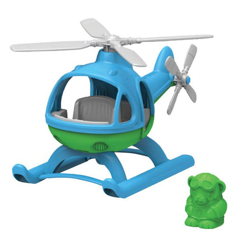 A plastic mostly blue Helicopter with grey blades and a green underbelly with a green pilot next to it