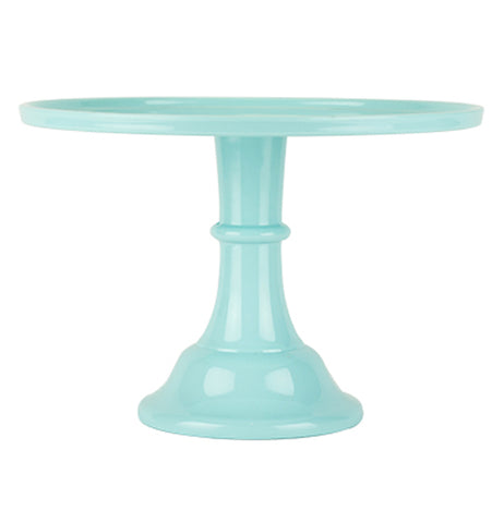This is a mint colored melamine stand for holding cake.