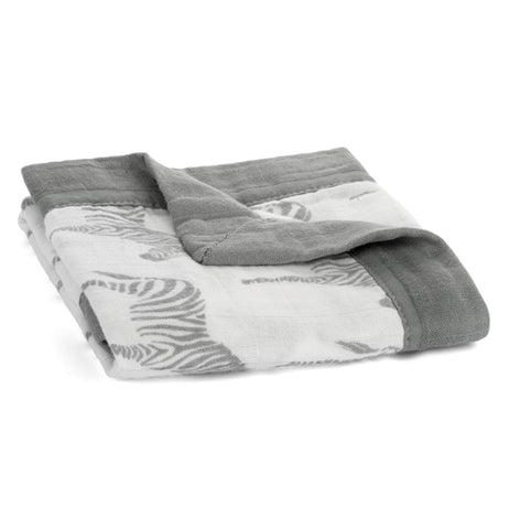 The gray and white blanket with a zebra design is shown folded.