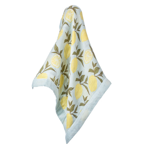 This light blue blanket features a design yellow lemons with forrest green leaves.