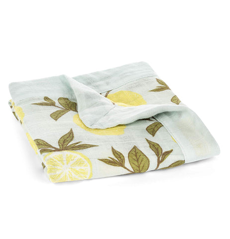 Shown here the light blue blanket with yellow lemons and forrest green leaves folded.