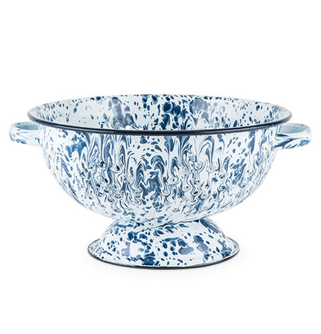 This colander is white with a blue mottled design and a black rim on its top and bottom.