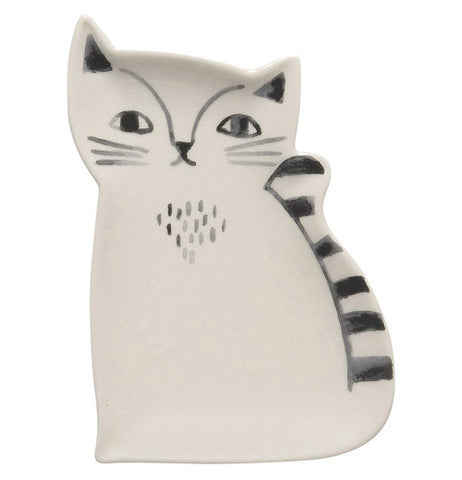 "The close-up of the Trinket Trap shows the image of the white ""Ceramic Cat"" that has whiskers and striped tail."