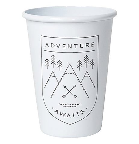 "The ""Adventure Awaits"" Tumbler has three mountains with two arrows crossing on the center one, and pine trees with the words ""Adventure Awaits""."