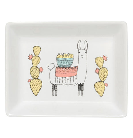"The ""Llamarama"" Glass Tray shows a llama holding a bowl filled with pumpkins standing between two yellow cacti."