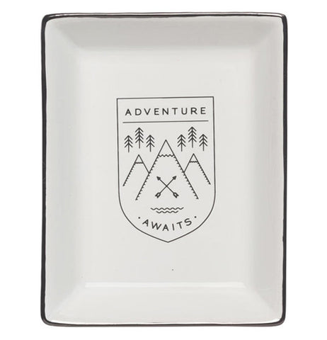 "The Glass Tray has a message, ""Adventure Awaits"" with a symbol of six pine trees and three snow capped mountains with two arrows crossing in the center."