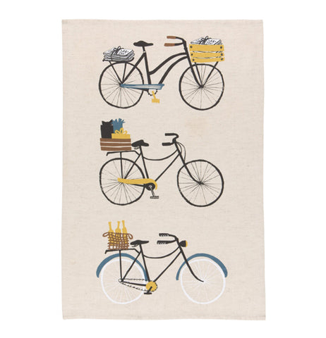 """Bicicletta"" tea towel with design of 3 bikes over a white background."
