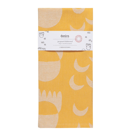 """Crecsendo"" jacquard yellow tea towel with white shape design folded up with a white wrapper band on it."