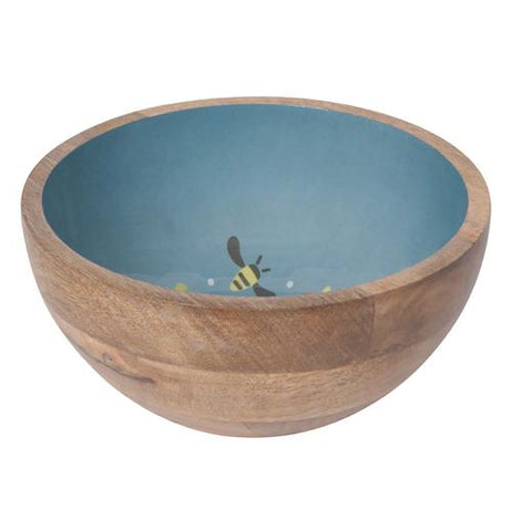 The wooden exterior of the blue bowl with the pictures of the bees and flowers is shown.