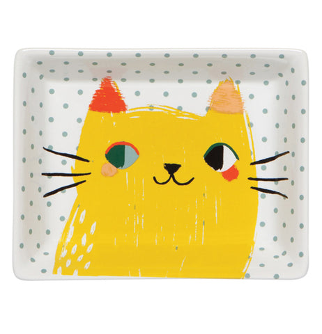 White Tray with black spots and a yellow cat with an red and orange ears with black whiskers and different color of eyes.