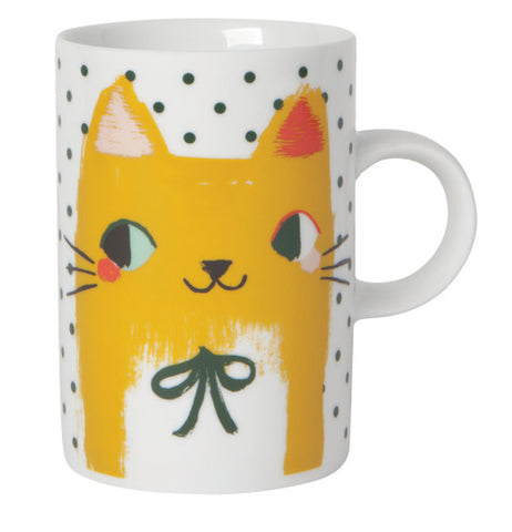 "The ""Meow Meow"" Mug features a smiling yellow cat over a white and green dotted background."