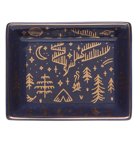 A Navy Blue trinket tray with a gold design that shows the stars and the moon and the  pine trees and the Northern Lights.