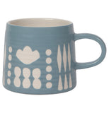 A ceramic blue mug with rounded shapes and diamonds over a white background.