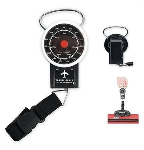 Travel luggage scale with strap for weighing luggage Travel luggage scale being used to weigh out the luggage before a flight.