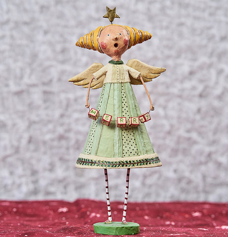 The figurine is wearing a mint green and white outfit with golden hair in a cone. The figurine is on a red table, with a white background