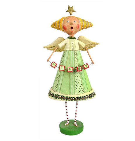 The figurine is wearing a mint green and white outfit with golden hair in a cone.