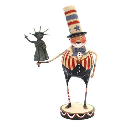 This figure is dressed in an outfit and top hat designed after the American Flag, and holding a miniature statue of liberty.