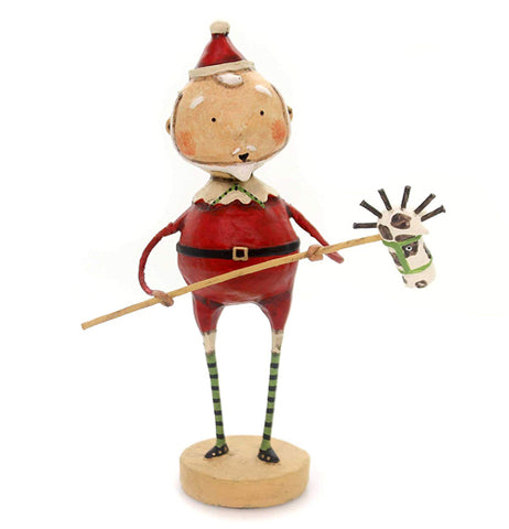 A polyresin Santa figure is holding a stick horse. The photo is from front. There is no background. He has green striped socks that go above his knees.
