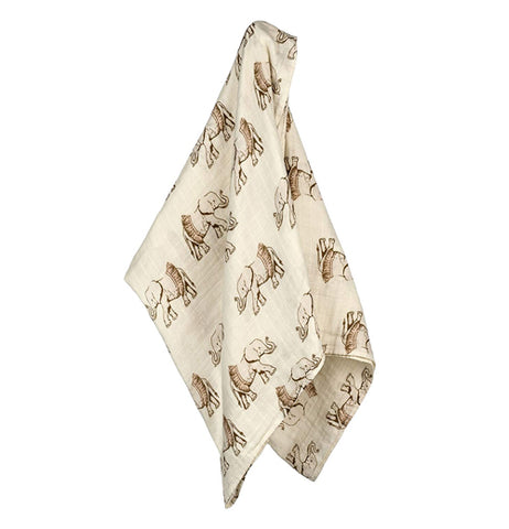 This white baby blanket features a design of gray elephants wearing brown tutus.