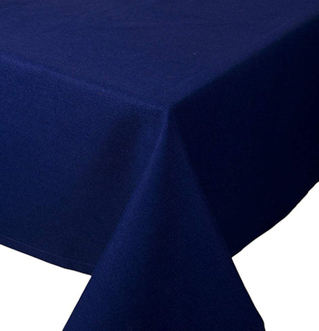 This indigo tablecloth is shown folded at the end of the table.