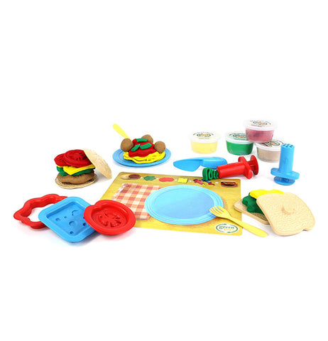 The Meal Maker Dough Set has 18 piece toy set, including 1 spaghetti extruder, 1 flat extruder, 1 knife, 1 cheese stamp, 1 tomato stamp, and 1 sauce cutter.